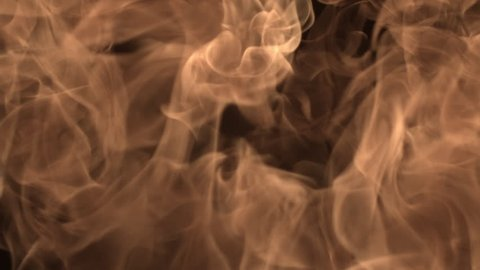 A slow motion close up shot of fire building up and disappearing.