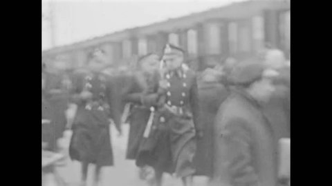 CIRCA 1940s - Prisoners arrive from Camp Vught by train to the Westerbork Concentration Camp and are registered, in the Netherlands.