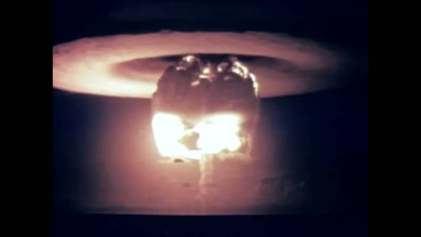 CIRCA 1954   A Nuclear Device Is Detonated From A Firing Barge And The  Resulting Mushroom