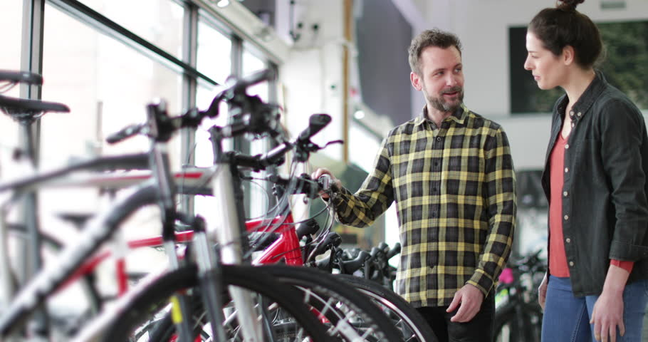 Small business owner serving customer in a bike store