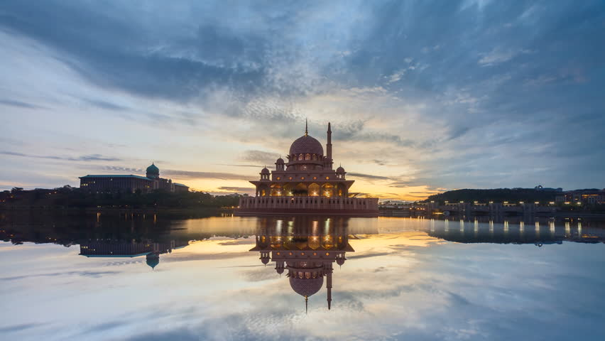 4K Beautiful Sunrise Time Lapse with calm reflection at Masjid Putra by a lake in Putrajaya, Malaysia from night to day