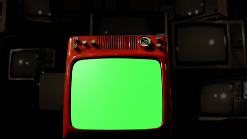 Old Red Tv Green Screen in the Middle of Many Tvs. Dolly Rolling In for a Close-Up. Fading Sepia Tone to a Black Background. | Shutterstock HD Video #1009488746