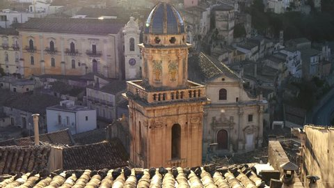 Ragusa Ibla, Sicily, Italy. Maiolica roofed bell tower of Santa Maria dell'Itria church at sunset
