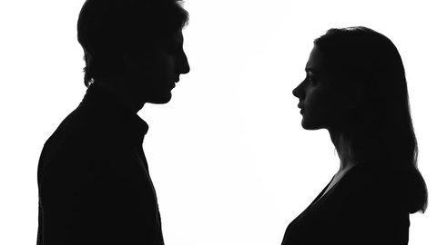 Man leaving upset young woman, husband going away, couple break-up, divorce