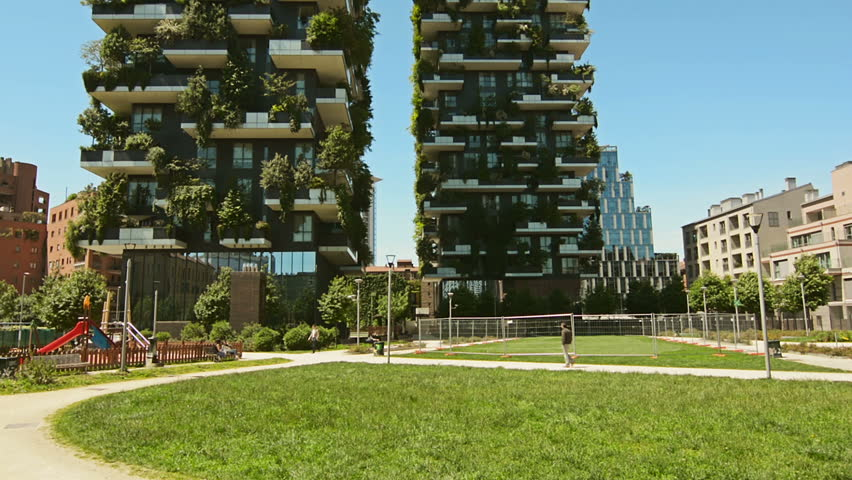 MILAN, ITALY - CIRCA 2017: Vertical Forest or Bosco Verticale, a pair of modern, ecological residential buildings. Terraces with trees and plants, sustainable concept, air cleaners.
