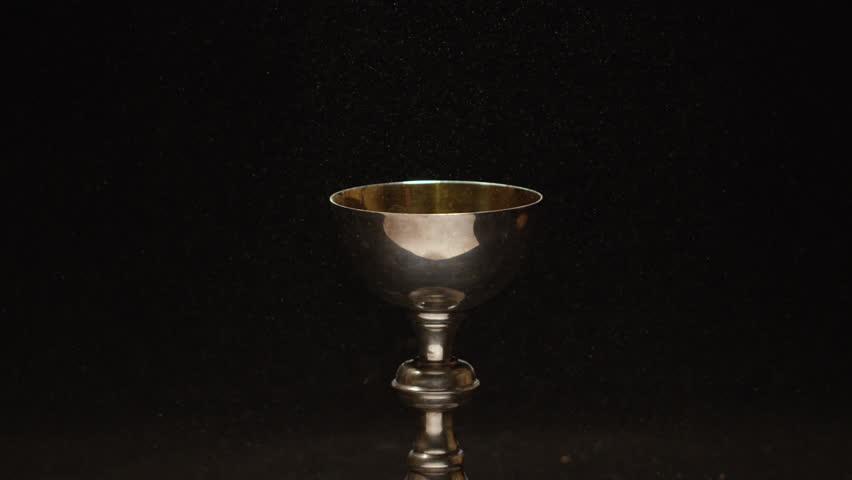 Catholic golden chalice slow motion dust