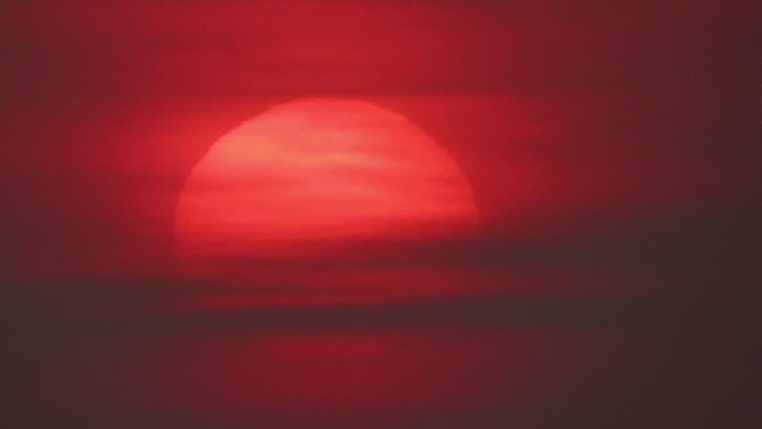 Sunset Yellow Sun Through Clouds Stock Footage Video - Sunrise looks like mars
