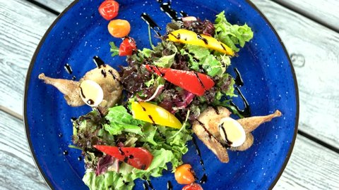 Quail salad top view. Delicious and healthy food.