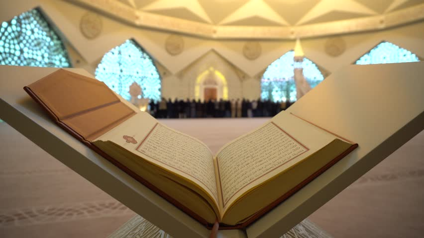 Quran or Koran - holy book and Muslim People praying in Mosque with sound  ISTANBUL, TURKEY - MARCH 2018 | Shutterstock HD Video #1009641476