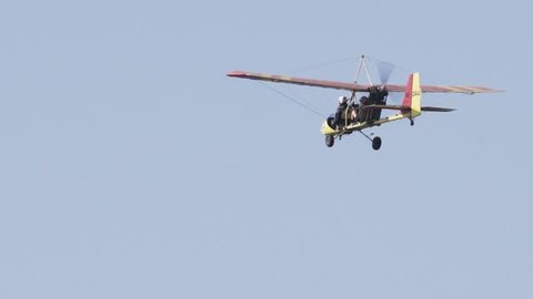 Small Cessna Airplane Flying with two passengers aboard