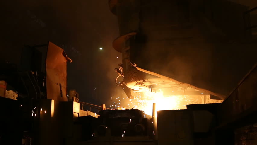 Plant for the production of steel. An electric melting furnace. Factory worker takes a sample for metal. | Shutterstock HD Video #1009712756