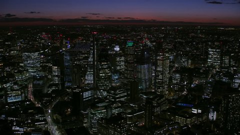 Aerial night view London financial district modern commercial skyscrapers office lights and cityscape England United Kingdom RED WEAPON