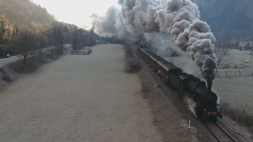Historic steam train rolling through the valley