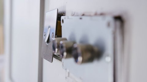 Close Up Of Electric Light Switches And Dimmers Being Fitted