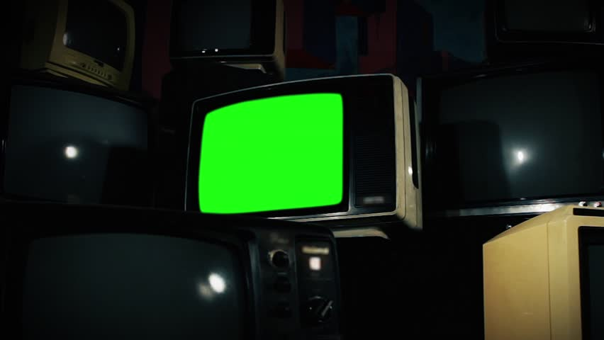 Old Tv Green Screen with Many 1980s Tvs. Zoom In Fast. Ready to replace green screen with any footage or picture you want. | Shutterstock HD Video #1009774016