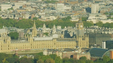 Aerial sunrise view London cityscape of Parliament Palace of Westminster River Thames England UK RED WEAPON