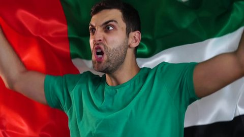 United Arab Emirates Fan Celebrating with Flag