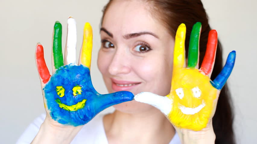 Portrait student girl smiling girl showing painted colorful hands with smiles. Concept education, creativity, art and painting. light white background. | Shutterstock HD Video #1009823876