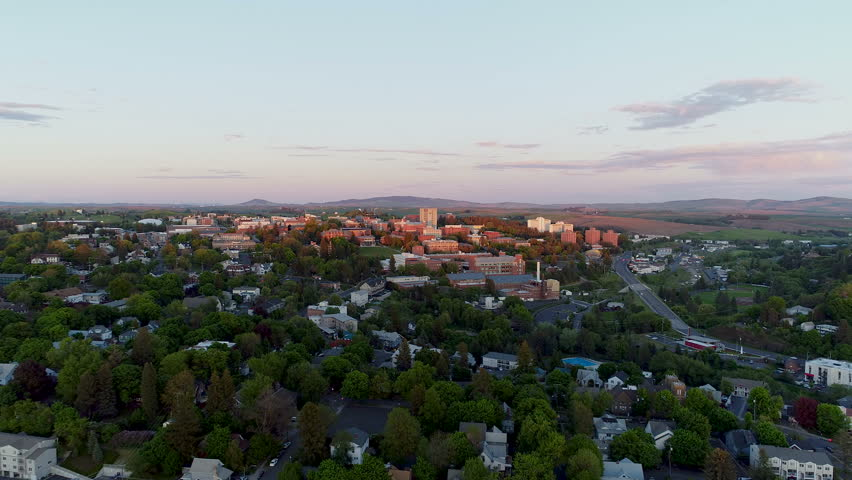 Sunset aerial shot flying towards University campus in Washington State