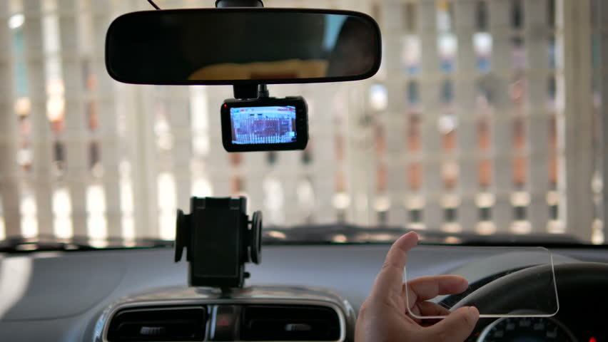 Hands of man using clear tablet in a car for transport futuristic and technology concept  | Shutterstock HD Video #1009850666