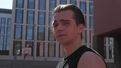 Portrait Of Man Guy Showing Fuck You on a Street - sunny Day