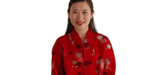 681d3ecd2 Portrait of Asian millennial wearing red traditional Chinese outfit and  smiling for camera isolated on white