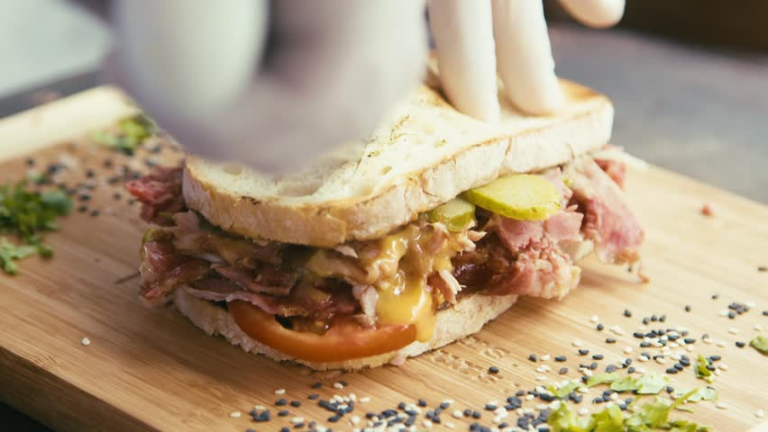 Cutting and serving a pulled pork and mayo sandwich