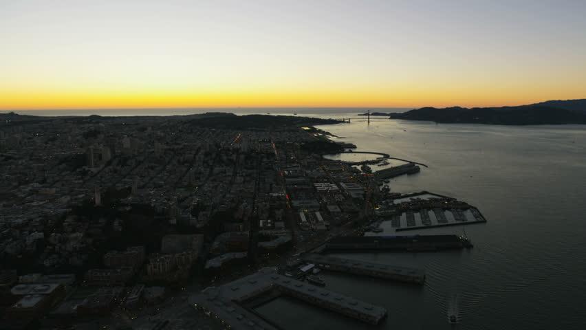 Aerial night illuminated night cityscape view of Fishermans Wharf Pier 39 Marina district San Francisco Bay Golden Gate Marin Headlands California America