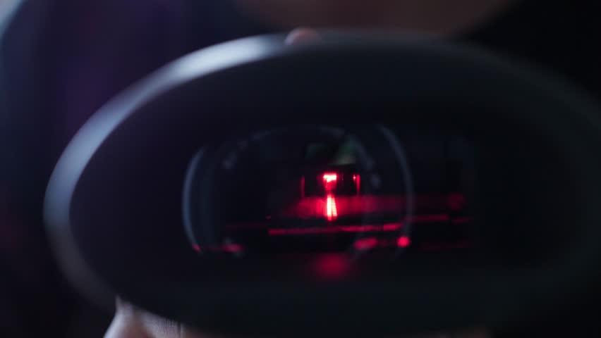 Red laser barcode scanner close up, scanning lense | Shutterstock HD Video #1009929686
