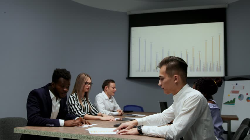 Conclusion multietnicita mutually beneficial transactions between African American and European. Transfer of ownership in the conference room. The Board of Directors. Business meeting.   Shutterstock HD Video #1009936076