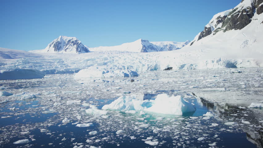 Antarctica floating sea ice glaciers icebergs and mountains reflections | Shutterstock HD Video #1009936886