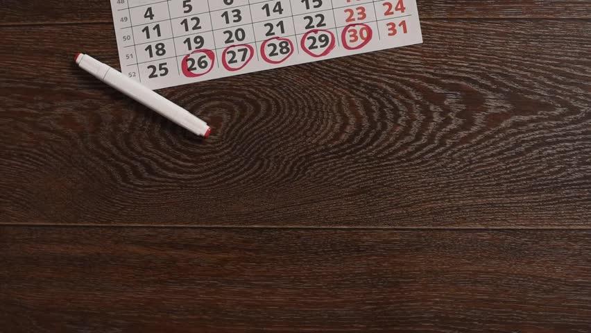 Underwear, a calendar with menstruation dates, hygiene tampons and gaskets | Shutterstock HD Video #1009946396