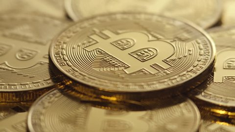 Crypto currency, bitcoin. BTC, Bit Coin. Blockchain technology, bitcoin mining. Macro shot of rotating bitcoins