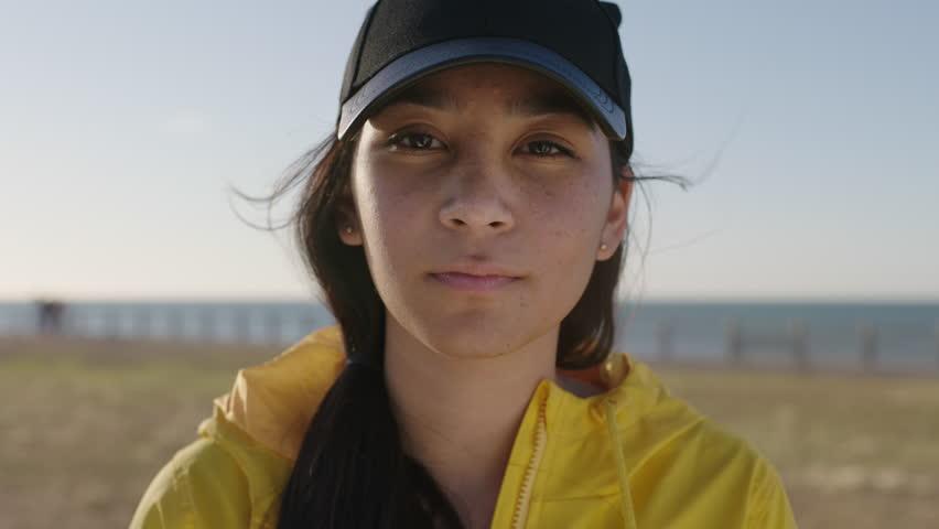 close up portrait of awkward teenage girl smiling cheerful looking at camera wearing braces enjoying sunny seaside park real people series