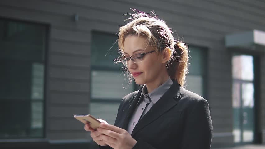 Close-up portrait of business woman with mobile phone hands   Shutterstock HD Video #1009964456