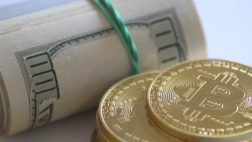 Gold bitcoin roll and rotate on a money background. Dollar,euro | Shutterstock HD Video #1009998626