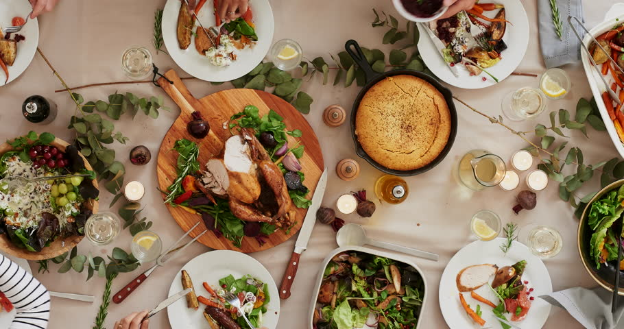 Top view of young happy multi ethnic friends preparing table enjoying vibrant thanksgiving lunch together talking bonding over healthy meal time lapse tracking | Shutterstock HD Video #1010010236