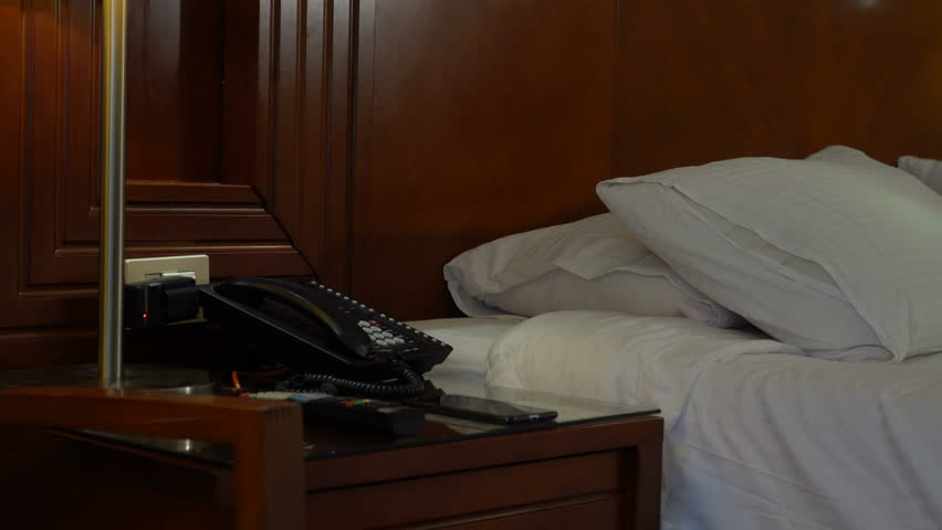 Bedroom with telephone in front and bed in the background | Shutterstock HD Video #1010014406