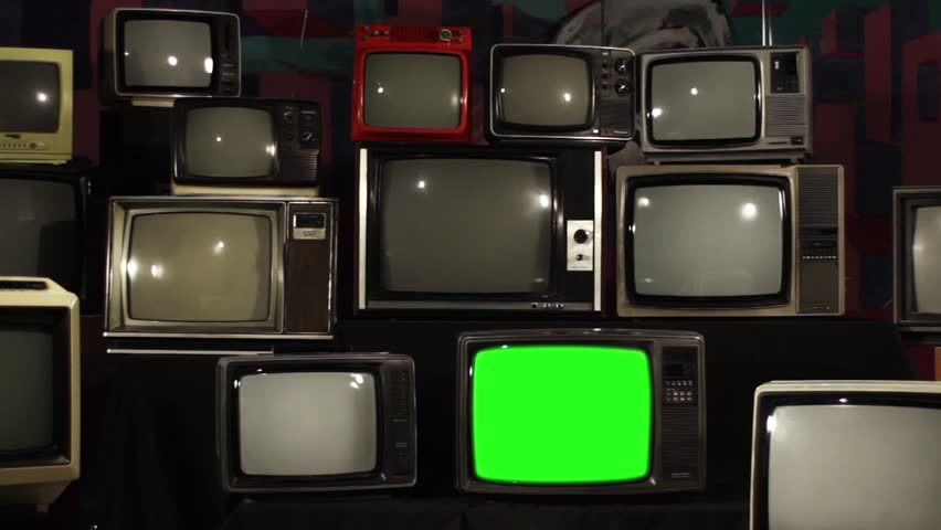 Aesthetic Televisions of the 80s with Green Screens that Light Up. Zoom Out Fast. Ready to replace green screen with any footage or picture you want.  | Shutterstock HD Video #1010055176