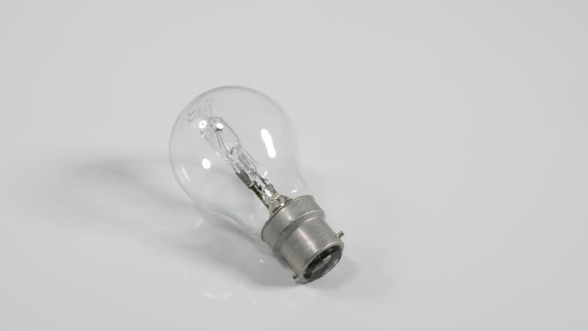 4K Light bulb rolling on white surface background, moving object, energy efficient tungsten lamp | Shutterstock HD Video #1010071736