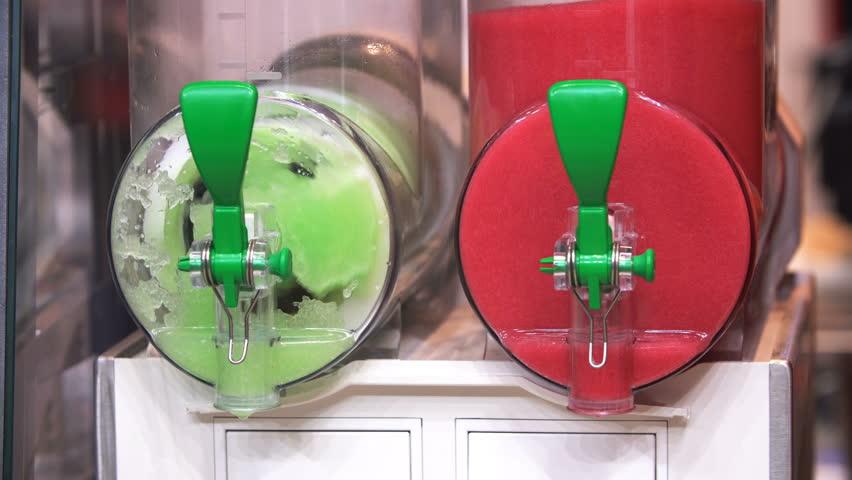 4K footage of colourful, cool, refreshing ice king slushy refreshment machine close up view