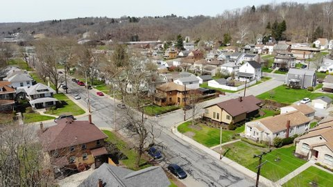 pennsylvania, pa, neighborhood, residential, homes, houses, above, flyover, forward, view, day, daytime, exterior, establishing shot, small town, valley, overhead, community, winter, spring, rust belt