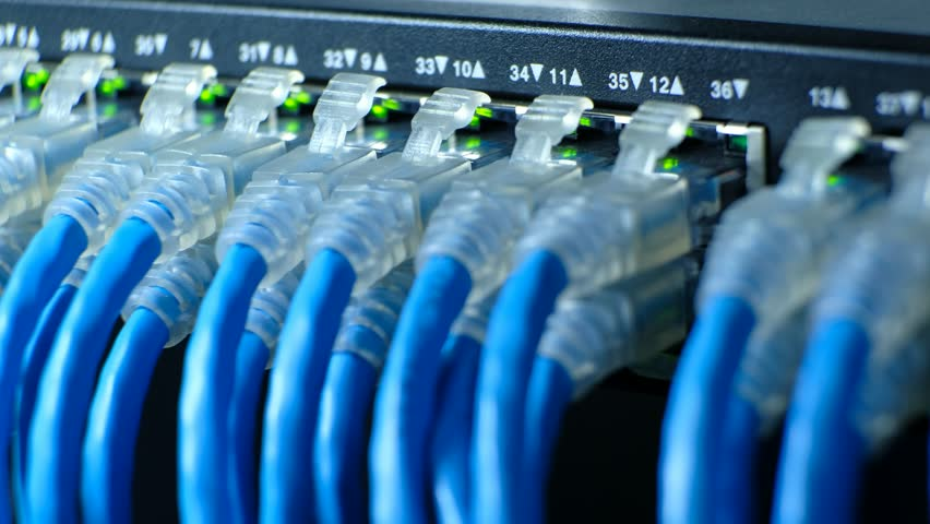 Network cable connecting on Network gigabit switch and LED port status is blink. UTP port cat6 for high speed network in data server room. close up and selective focus | Shutterstock HD Video #1010104406