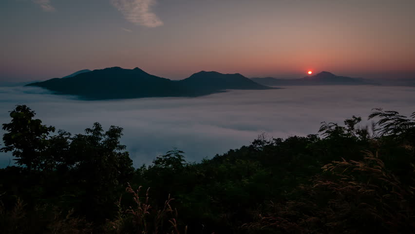 Sunrise and morning Mist at Phu Tok, Loei Thailand. (Time Lapse)