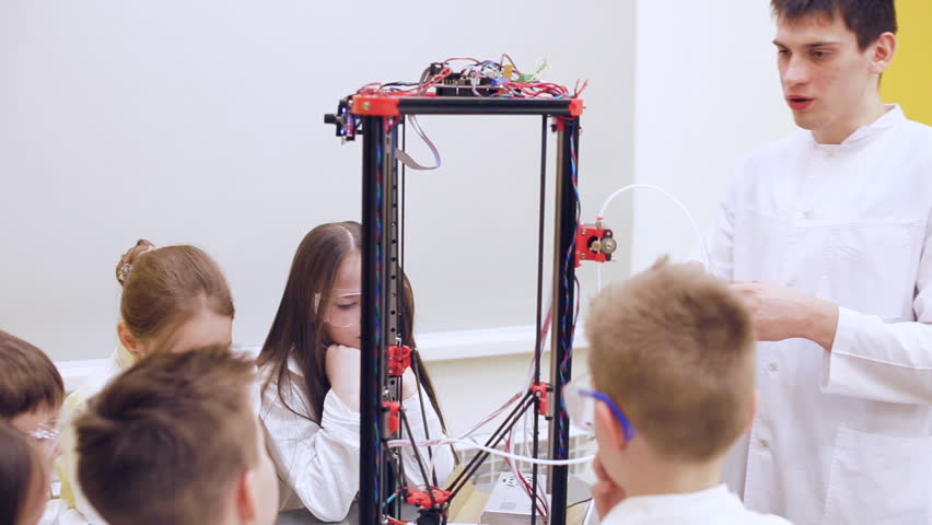 Children at school are studying a 3d printer | Shutterstock HD Video #1010126816