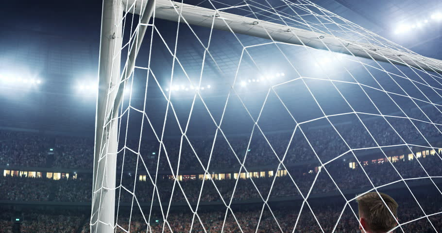 Soccer goalkeeper jumps and fails to catch ball on a professional soccer stadium. Stadium and crowd is made in 3D and animated
