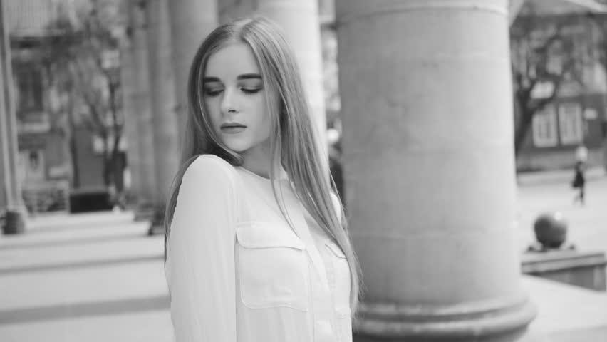 Summer lifestyle fashion portrait of young beautiful blonde stylish hipster woman wearing white shirt   Shutterstock HD Video #1010148266