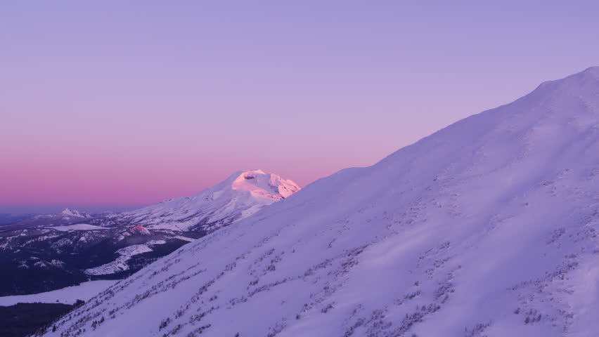 South Sister and Mt. Bachelor, Oregon circa-2018.  Morning aerial view of South Sister mountain revealed from Mt. Bachelor, Oregon. Shot from helicopter with Cineflex gimbal and RED Epic-W camera.