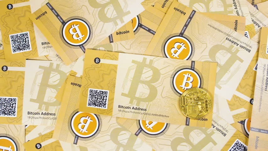 Macro upper view first decentralized financial system symbols bitcoins and litecoins on paper banknotes | Shutterstock HD Video #1010180576