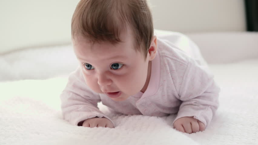 Two month old baby lie on stomach and trying to keep your head   Shutterstock HD Video #1010198846